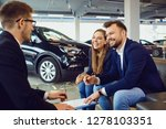 couple buys a car in a car... | Shutterstock . vector #1278103351