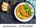 Breakfast. Omelette with tomatoes, avocado, blue cheese and green peas on white plate.  Frittata - italian omelet. Top view