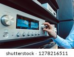 hand of woman turning up volume ... | Shutterstock . vector #1278216511