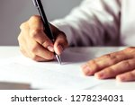 businessman signing a document... | Shutterstock . vector #1278234031