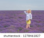 young girl posing in a lavender ... | Shutterstock . vector #1278461827