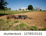 Small photo of Amish Farm Equipment in Field on a Sunny Summer Day
