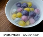 coloured dumplings in bowls | Shutterstock . vector #1278544834