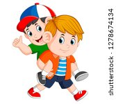 the strong boy is carrying his... | Shutterstock .eps vector #1278674134