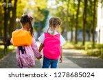 two children go to school with... | Shutterstock . vector #1278685024