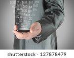Businessman uses smart phone with virtual envelopes - stock photo