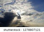 sunbeams peaking through clouds ... | Shutterstock . vector #1278807121