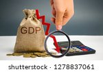 Small photo of Money bag with the word GDP and down arrow. Decline and decrease of GDP - failure and breakdown of economy and finances leading to financial crisis and trouble. Drop in gross domestic product