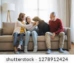 a senior couple with a teenage... | Shutterstock . vector #1278912424