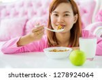 asian woman eating healthy... | Shutterstock . vector #1278924064
