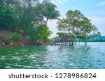 the silhouette of old nipa hut... | Shutterstock . vector #1278986824