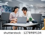 working using laptop. curly guy ... | Shutterstock . vector #1278989134