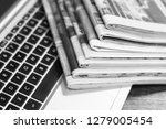 newspapers and laptop. pile of... | Shutterstock . vector #1279005454