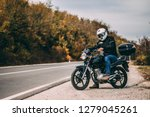 guy with the motorcycle | Shutterstock . vector #1279045261