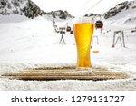 winter time in alps and beer in ... | Shutterstock . vector #1279131727