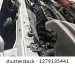 engineer hands fixing engine... | Shutterstock . vector #1279135441