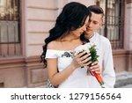 groom holds bride tender in his ... | Shutterstock . vector #1279156564