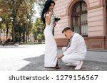 groom helps bride to fix shoes... | Shutterstock . vector #1279156567