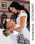 groom holds bride tender in his ... | Shutterstock . vector #1279156597