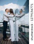 groom holds bride tender... | Shutterstock . vector #1279156771