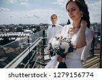 bride with wedding bouquet... | Shutterstock . vector #1279156774