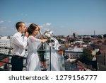 groom holds bride tender... | Shutterstock . vector #1279156777