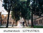 the bride and groom walking... | Shutterstock . vector #1279157821