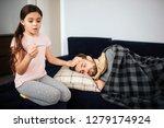 scared small girl sitting... | Shutterstock . vector #1279174924