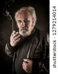 grumpy senior man smoking... | Shutterstock . vector #1279214014