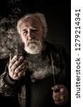 grumpy senior man smoking... | Shutterstock . vector #1279214341