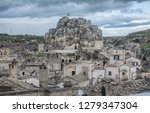 matera is an atmospheric cave... | Shutterstock . vector #1279347304