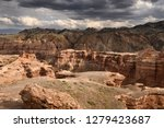 dark clouds over charyn canyon...   Shutterstock . vector #1279423687