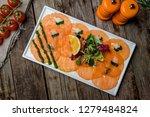 salmon carpaccio on a plate | Shutterstock . vector #1279484824