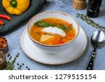 fish soup on white plate | Shutterstock . vector #1279515154