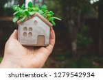 woman with house in hand. area... | Shutterstock . vector #1279542934