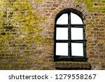 mossy brick wall with a old... | Shutterstock . vector #1279558267