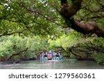 Tourists On A Bamboo Raft...