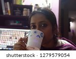 indian bengali woman is sipping ... | Shutterstock . vector #1279579054