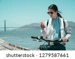 Girl Traveler Walk With Bike I...