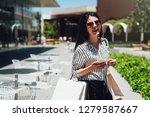 beautiful girl in sun glasses... | Shutterstock . vector #1279587667