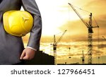 engineer holding yellow helmet... | Shutterstock . vector #127966451