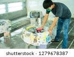 man bodybuilder to work on car... | Shutterstock . vector #1279678387