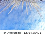 icicles hanging from the edge... | Shutterstock . vector #1279726471