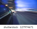 night drive with car in motion. | Shutterstock . vector #127974671