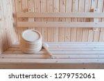 wooden bucket in sauna room on... | Shutterstock . vector #1279752061
