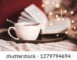 cup of black tea with open book ... | Shutterstock . vector #1279794694