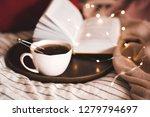 cup of balck tea with wooden... | Shutterstock . vector #1279794697