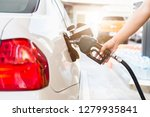 grey car at gas station being... | Shutterstock . vector #1279935841
