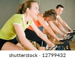 three people cycling in a gym... | Shutterstock . vector #12799432