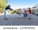 woman as a sports teacher shows ...   Shutterstock . vector #1279959241